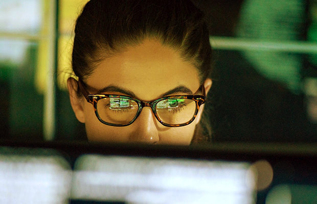 Close up of person working at computer